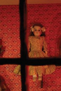doll-hanging-on-wall